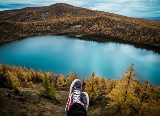 Shoes overhanging mountain